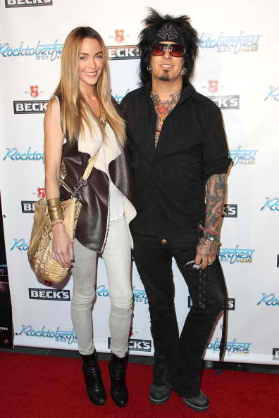 (L-R) Courtney Bingham and Nikki Sixx rocktoberfest red carpet