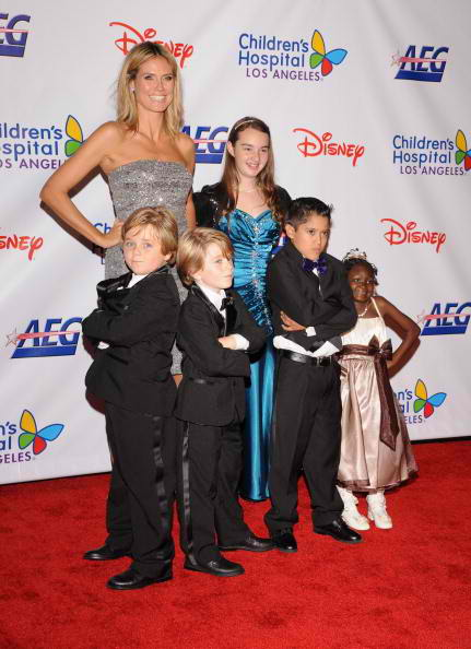 Project Runway host and Noche honoree Heidi Klum (L) and the patients and Junion Ambassadors