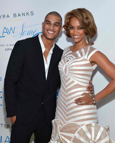 Rob Evans (L) and model media personality Tyra Banks