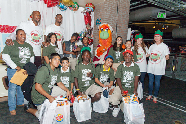 Chris Bosh and adrienne bosh donate gifts 2
