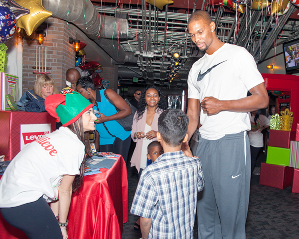 Chris Bosh and adrienne bosh donate gifts 5