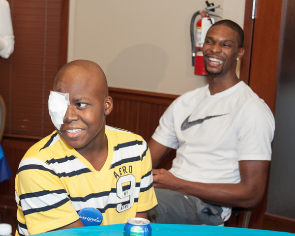 Chris Bosh and adrienne bosh donate gifts 7