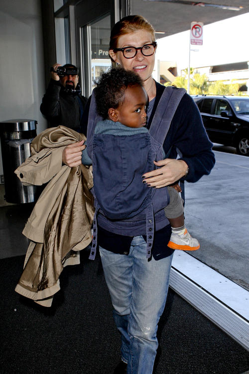 Connie Britton and son Yoby at LAX NYE 2012 1