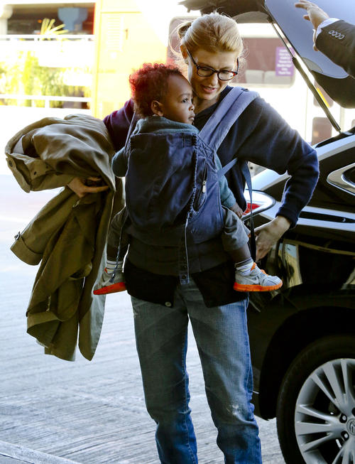 Connie Britton and son Yoby at LAX NYE 2012 4