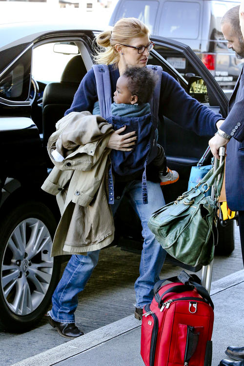 Connie Britton and son Yoby at LAX NYE 2012 5