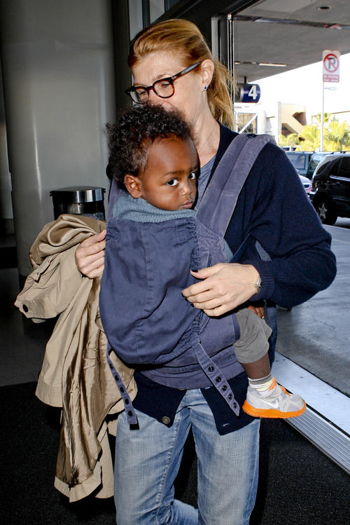 Connie Britton and son Yoby at LAX NYE 2012 6