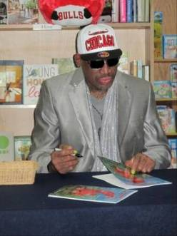 Dennis Rodman holding new book Dennis the wild bull 2
